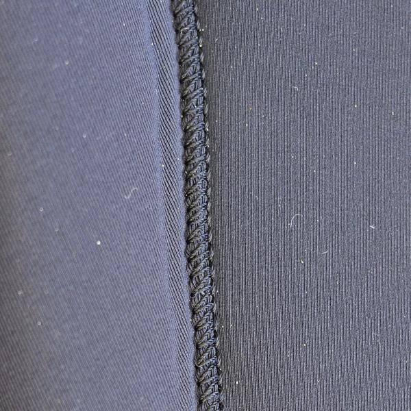 couture cousue collée combinaison de surf